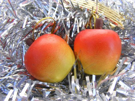 christmas decoration, wooden apple on silver basckground Stock Photo - 6080254
