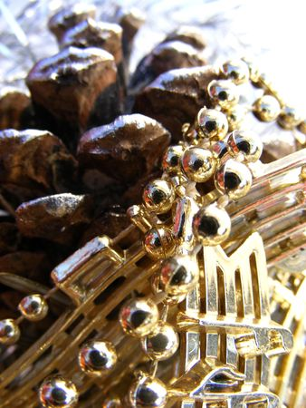 golden pearl on a cone, christmas decoration-detail Stock Photo