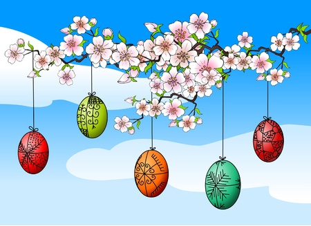 whit: Easter eggs hanging on a cherry tree whit flowers