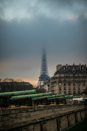 Cannons and the Eiffel Tower in fog Stock Photo