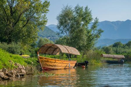Boat on Lake Skadar, Montenegro Stock Photo