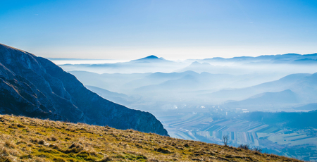 mountin: Top of a mountin  with foggy blue mountains in the background Stock Photo
