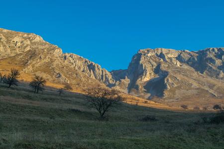 Autumn landscape with cliffsin the sun, Transylvania: Torocko, Rimetea