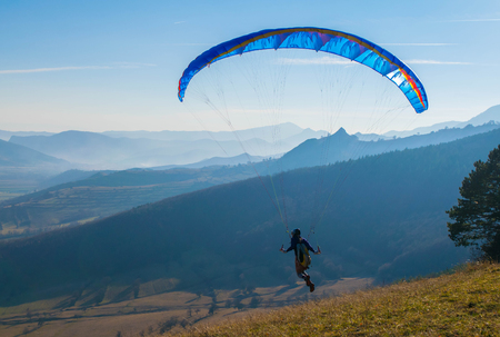 Launching paraglider