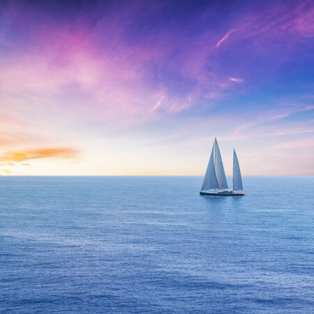 A Beautiful Sailing Boat on the Sea at Sunset Time