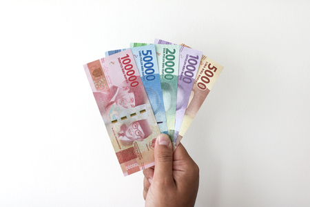 Man Hand show Indonesian Money Rupiah