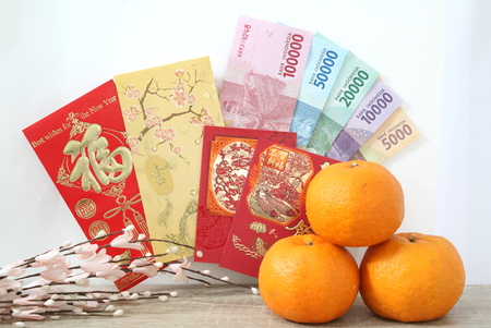 Chinese new year envelope with Indonesian rupiah money in table Stock Photo