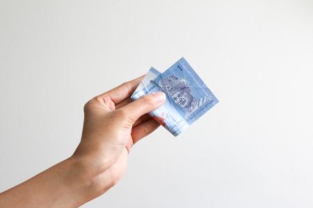 Malaysia Currency (MYR): One ringgit on hand Stok Fotoğraf - 82254468
