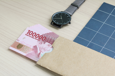 rupiah Indonesian money on top wood table
