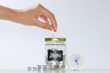 hand woman saving coin