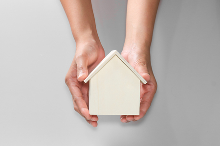 hand hold house investment insurance concept