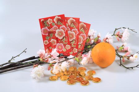 chinese new year celebration decoration. Orange, red envelope, gold money chocolate