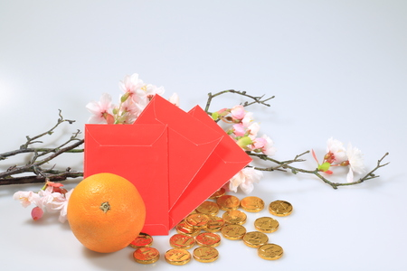 chinese new year celebration decoration. Orange, red envelope, gold money chocolate