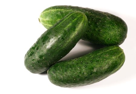 progressively: Cucumbers isolated on white