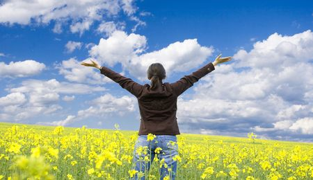 arms wide: Happy young woman in yellow field