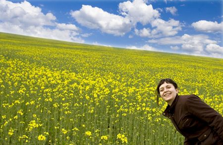 Young attractive girl having fun in summer rape field Stock Photo - 2955338