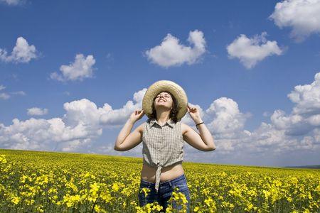 Young attractive girl enjoying summer rape field Stock Photo - 2955340