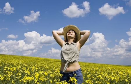 Young attractive girl ejoying summer field photo