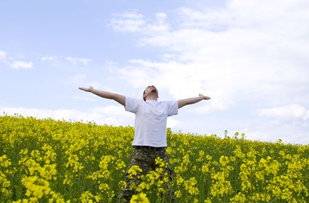 Young attractive man enjoying summer field Stock Photo - 2989022