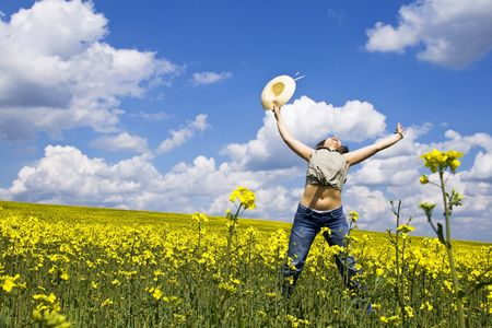 Young girl jumping in rape field Stock Photo - 3020706