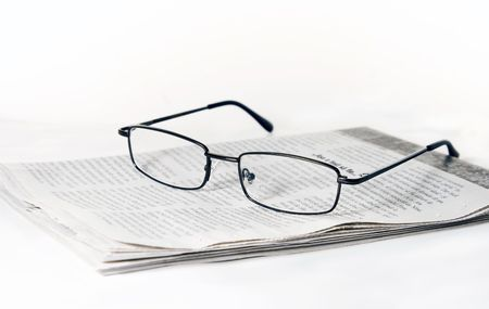Glasses on folded newspaper Stock Photo - 3177179