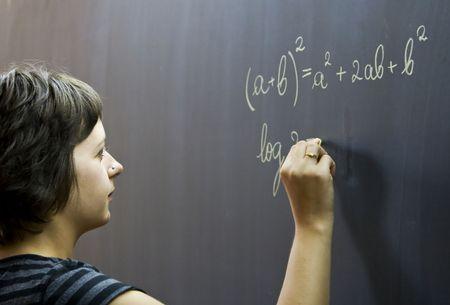 Teacher writing on the blackboard Stock Photo - 3457899