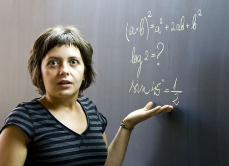 Confused student in front of a math formula Stock Photo - 3457901