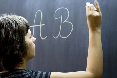 Teacher writing on the blackboard Stock Photo - 3457903