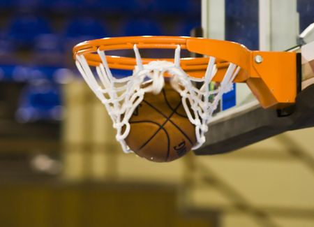 dunk: Ball in hoop Stock Photo