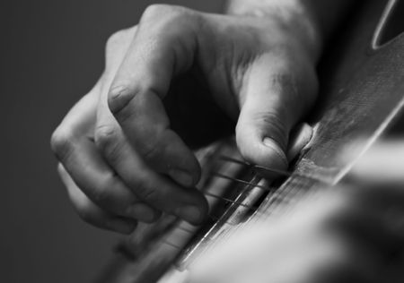 spanish guitar: Close up on male hand playing guitar
