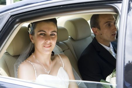 Bride and groom in car Stock Photo - 5144241