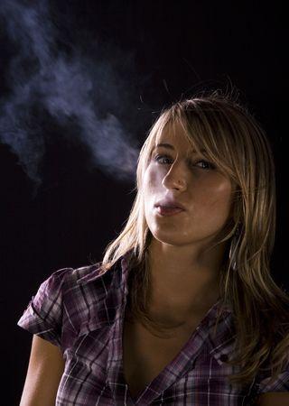 endangering: Young woman smoking Stock Photo