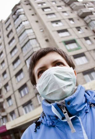 antiviral: Woman wearing medical mask Stock Photo