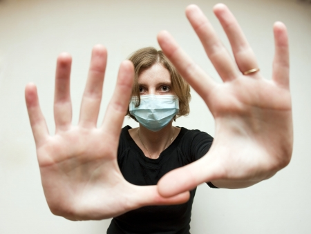 swine flu: Woman with medical mask