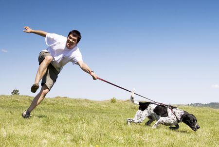 manly man: Man playing with his dog Stock Photo