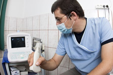 ultrasonic: Doctor looking at modern ultrasound device