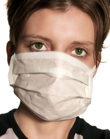Woman with big green eyes wearing medical mask protecting against flu virus photo