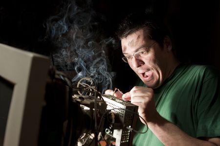 electric shock: Electricista en fuego Foto de archivo