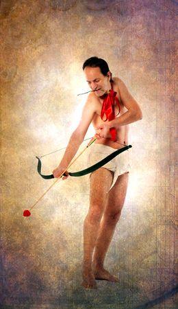 Flying Cupid on vintage postcard photo