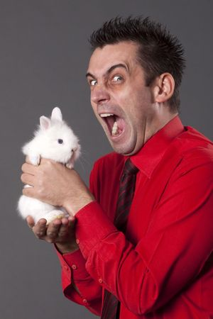 Funny man with white baby rabbit photo
