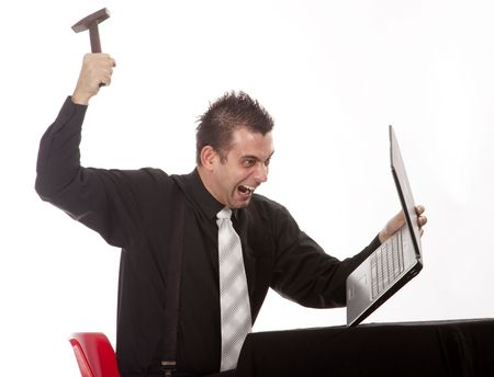 Businessman destroying his PC with a hammer photo