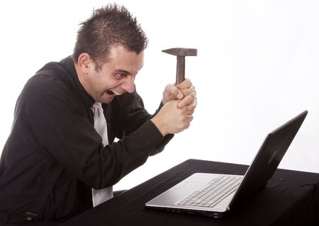 destroying: Businessman destroying his PC with a hammer Stock Photo