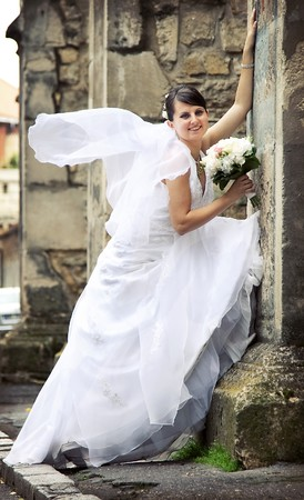 Beautiful bride posing among old church walls  Stock Photo - 7354342