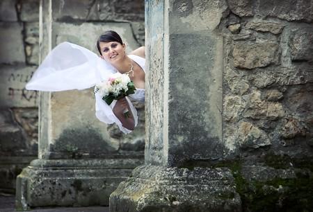 Beautiful bride posing among old church walls Stock Photo - 7354343