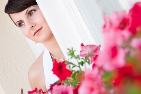 Attractive young woman face with flowers Stock Photo - 7354328