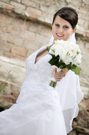 Portrait of the beautiful bride with a bouquet Stock Photo - 7348433