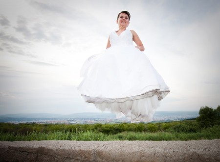 Happy bride jumping Stock Photo - 7347999