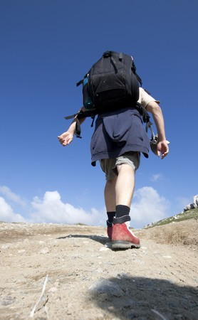 Man trekking in high mountains  photo