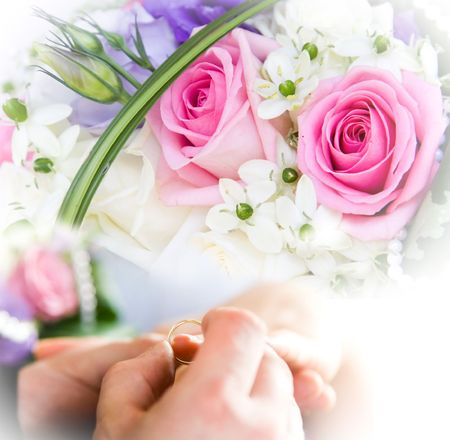 rose ring: hands and rings on bridal bouquet Stock Photo