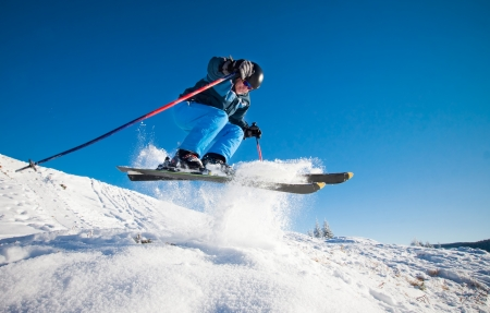 snow ski: Man practicing extreme ski on sunny day
